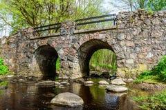 Stone arch bridge Stock Images