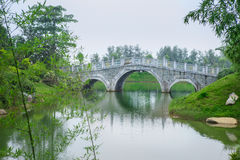 Stone arch bridge. In classical Chinese garden Royalty Free Stock Photography