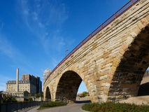 Stone Arch Bridge in Minneapolis 2. This is the Mill Ruins Park in Minneapolis, Minnesota. It features the Stone Arch Bridge and the ruins of flour mills Stock Photos