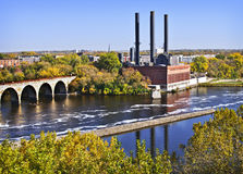 Stone Arch Bridge, Minneapolis, Minnesota. The Stone Arch Bridge, built in 1883 over the Mississippi River in Minneapolis, Minnesota, and the neighboring Stock Images