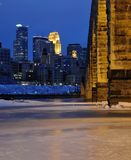 Stone Arch Bridge in Minneapolis. Stone Arch Bridge and Minneapolis Skyline at Night Stock Photos