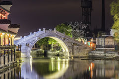 Stone arch bridge at night Royalty Free Stock Image