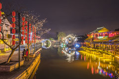 Stone arch bridge and Old time bar at night. This photo was taken in Xitang Town, Jiaxing city,Zhejiang province,china Stock Photos