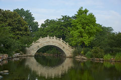 Stone arch bridge. A stone bridge of oriental style Royalty Free Stock Photo