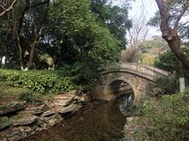 Stone arch bridge. Stone arch in the park, the winter stream almost dried up Stock Images