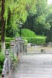 Stone arch bridge in rain. This photo was taken in Nanjing China Green Expo Garden ,Nanjing city, Jiangsu province, china Stock Photo