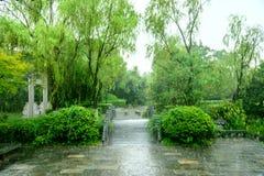 Stone arch bridge in rain. This photo was taken in Nanjing China Green Expo Garden ,Nanjing city, Jiangsu province, china Stock Photos