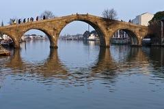 Stone arch bridge reflection in pond. Stone arch bridge of Shanghai, China, autumn time Royalty Free Stock Image