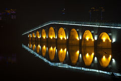 Stone arch bridge reflection in pond. Stone arch bridge of Shanghai, China, autumn time Stock Images