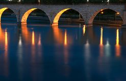 Stone Arch Bridge Reflections. Minneapolis, MN - copy/reflection space at bottom of image Stock Images