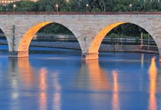 Stone Arch Bridge Reflections. Minneapolis, Minnesota - multiple images merged (HDR Royalty Free Stock Image