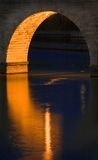 Stone Arch Bridge Reflections. Stone Arch Bridge Arch Reflection - Minneapolis MN - one arch reflects on water of Mississippi River Stock Photo