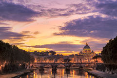 Stone Arch Bridge and Saint Peter Basilica. Beautiful Night View at Rome Italy with Historic Stone Made River Bridge Structure and Saint Peter Basilica View Stock Image