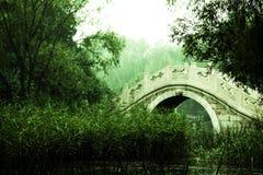 A Stone Arch Bridge. Stone arch bridge scenery tree green Royalty Free Stock Image