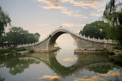 Stone arch bridge in summer palace. Beautiful stone arch bridge at the summer palace in beijing, China Royalty Free Stock Image