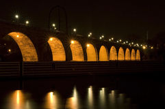 Stone Arch Bridge Under Lights. Stone Arch Bridge in Minneapolis Minnesota at night royalty free stock photo