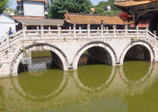 Stone arch bridge. In Yuantong temple ,Kunming China Royalty Free Stock Photos