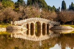 Stone arch bridge. In Yunnan Ethnic Minority Village, Yunnan, China Royalty Free Stock Photos