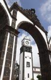 Stone arch and church. Ponta Delgada. Sao Miguel. Azores. Portug. Al. Vertical Stock Photo