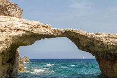 Stone arch on Comino island Stock Images