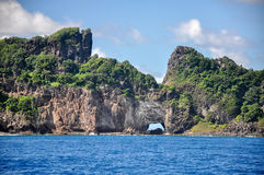 Stone arch on Fernando de Noronha, Pernambuco (Brazil) Stock Photos