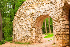 Stone arch in the forest Royalty Free Stock Photos