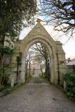 Stone arch gateway to church. The historic Albert Gate entrance to Saint Anne`s church on the island of Alderney in the British Channel Islands Stock Images