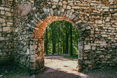 Stone arch. Of a historic building in the city park royalty free stock photo