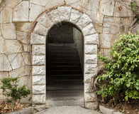 Stone arch with internal stairs. In park Royalty Free Stock Photos