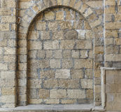 Stone arch lined with large bricks. Texture Stock Images