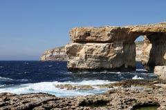 A stone arch on Malta, Azure Window. A stone bridge on the shore of Gozo Island, part of Malta inthe Mediteranian called Royalty Free Stock Image