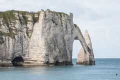 Stone Arch in Normandy coast in France. Impressive view of the cliff of the Normandy coast in France Royalty Free Stock Photo