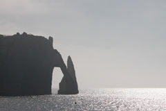 Stone Arch in Normandy coast in haze Royalty Free Stock Images