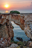 Stone arch over coastline Royalty Free Stock Image