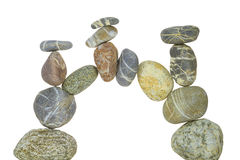 Stone Arch. An arch of pebbles against white background Royalty Free Stock Images