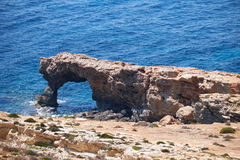 The stone arch of Ras il-Hamrija, Malta Royalty Free Stock Photography