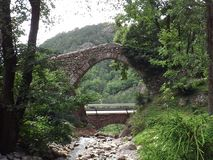 Stone arch on the river Royalty Free Stock Images