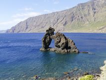 The stone arch Roque de Bonanza at El hierro coast, Canary Islands, Spain. The stone arch Roque de Bonanza at El hierro coast, Canary Islands in Spain stock photos