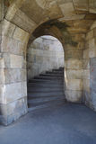 Stone arch and steps in castle. Medieval doorway. Spiral stairway Stock Photo