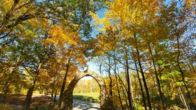 Stone Arch surrounded by Fall Trees Royalty Free Stock Photography