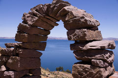 Stone Arch at Taquile Island, Lake Titicaca, Peru. Taquile Island, Peru: A historic stone arch with view over Lake Titicaca Stock Image