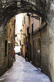 Stone arch to narrow alleyway Stock Photography