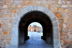 Stone arch in the wall of Avila, Spain Stock Photos