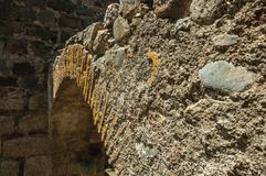 Stone arch in wall on the historical city center. Close-up of stone arch in wall encircling the historical city center on a sunny day at Castelo de Vide. Nice stock photo