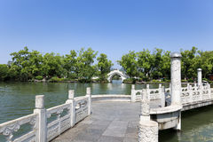 Stone arch and zigzag bridge in lake. Stone arch and zigzag bridge at banyan lake in guilin,China Royalty Free Stock Photography