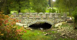 Stone arched bridge in the park Pheophany. Background Stock Image