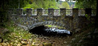 Stone arched bridge in the park Pheophany. Background Royalty Free Stock Photo