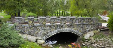 Stone arched bridge in the park Pheophany Royalty Free Stock Photos