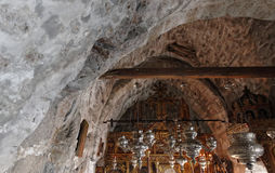 Stone arched chapel ceiling. Details of the stone arched ceiling of a chapel at the historic Hozoviotissa Monastery, Amorgos Island, Greece Royalty Free Stock Image