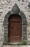 Stone arched doorway. Beautiful carved stone doorway. Very old Royalty Free Stock Photo